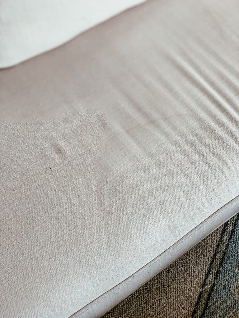 this is a photo of a water stain on a white sectional