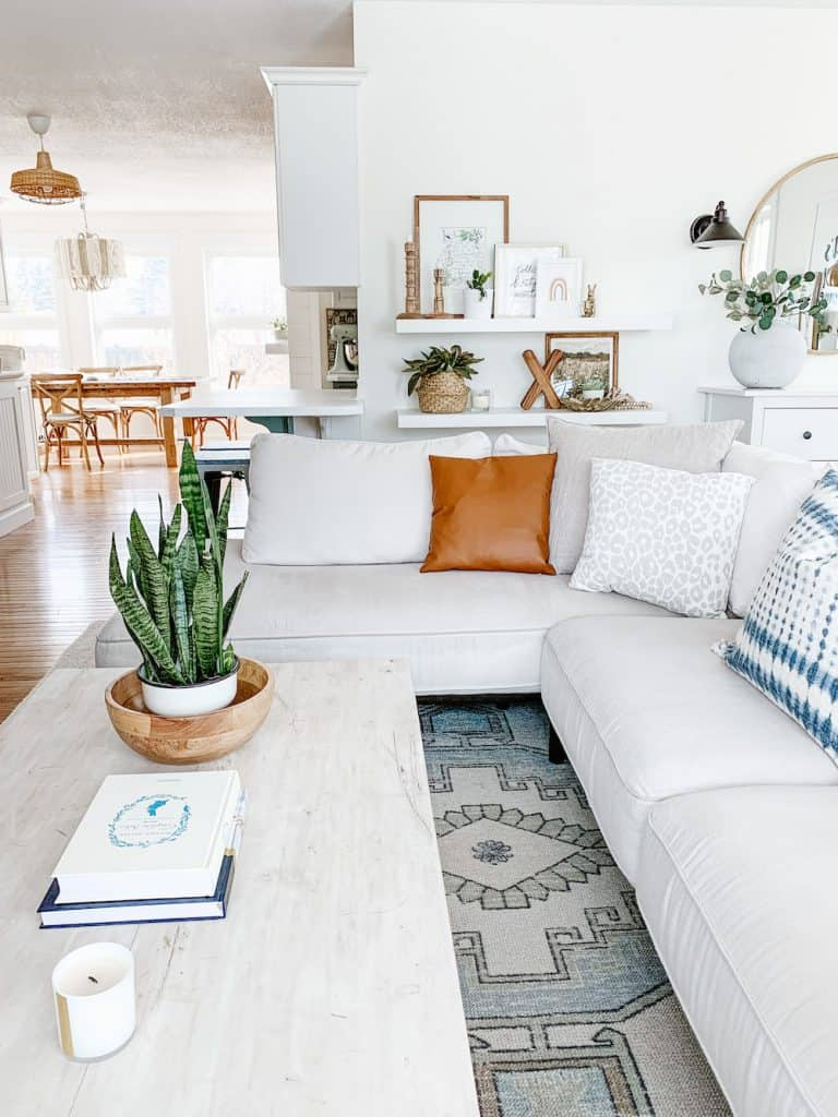 this is a photo of a white sectional in a living room