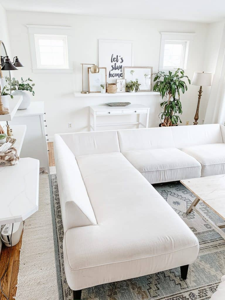 this is a photo of a white sectional ready to be cleaned in a living room