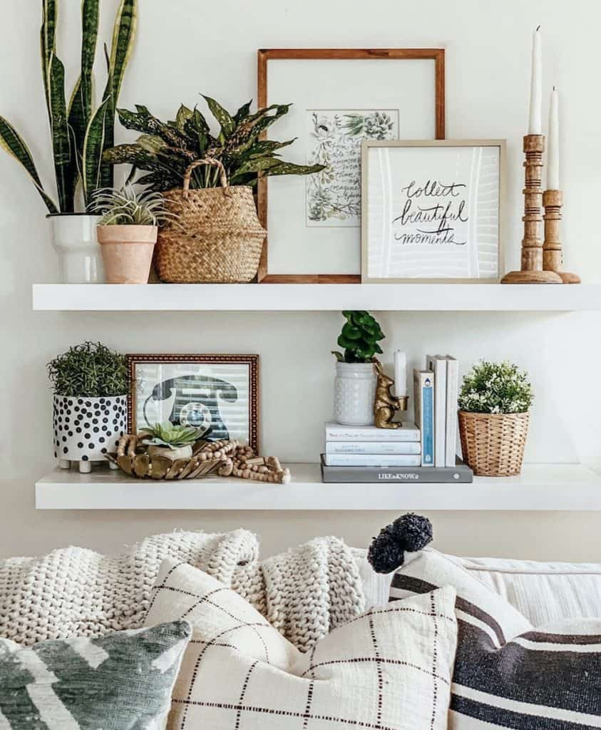 this is a photo of white floating shelves with lots of decor