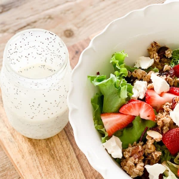 the best of summer salads- strawberries, granola, sweet red onion, goat cheese , homemade poppyseed dressing