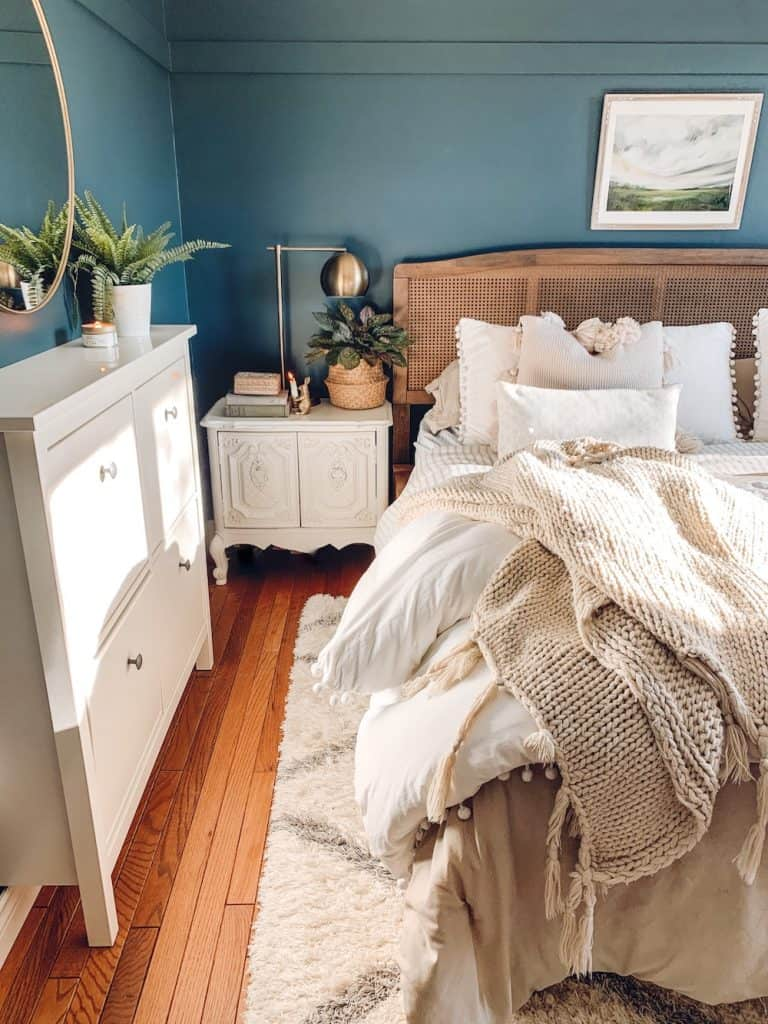 bedroom budget makeover, chimney by Behr walls, white pom pom bedding ikea shoe cabinet hack #ikeahack #bedroommakeover #smallbedroomideas #bohobedroomdesign