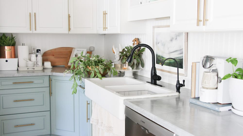 this is a photo of a newly renovated small kitchen with a farmhouse sink