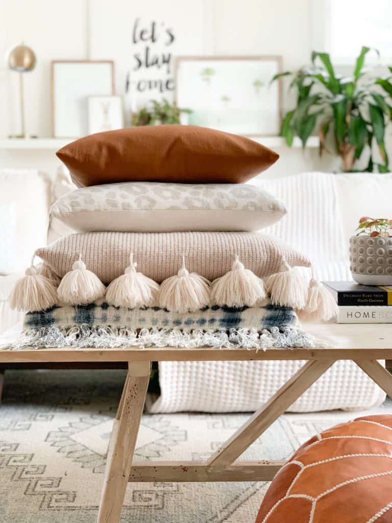 stack of pillows on a coffee table