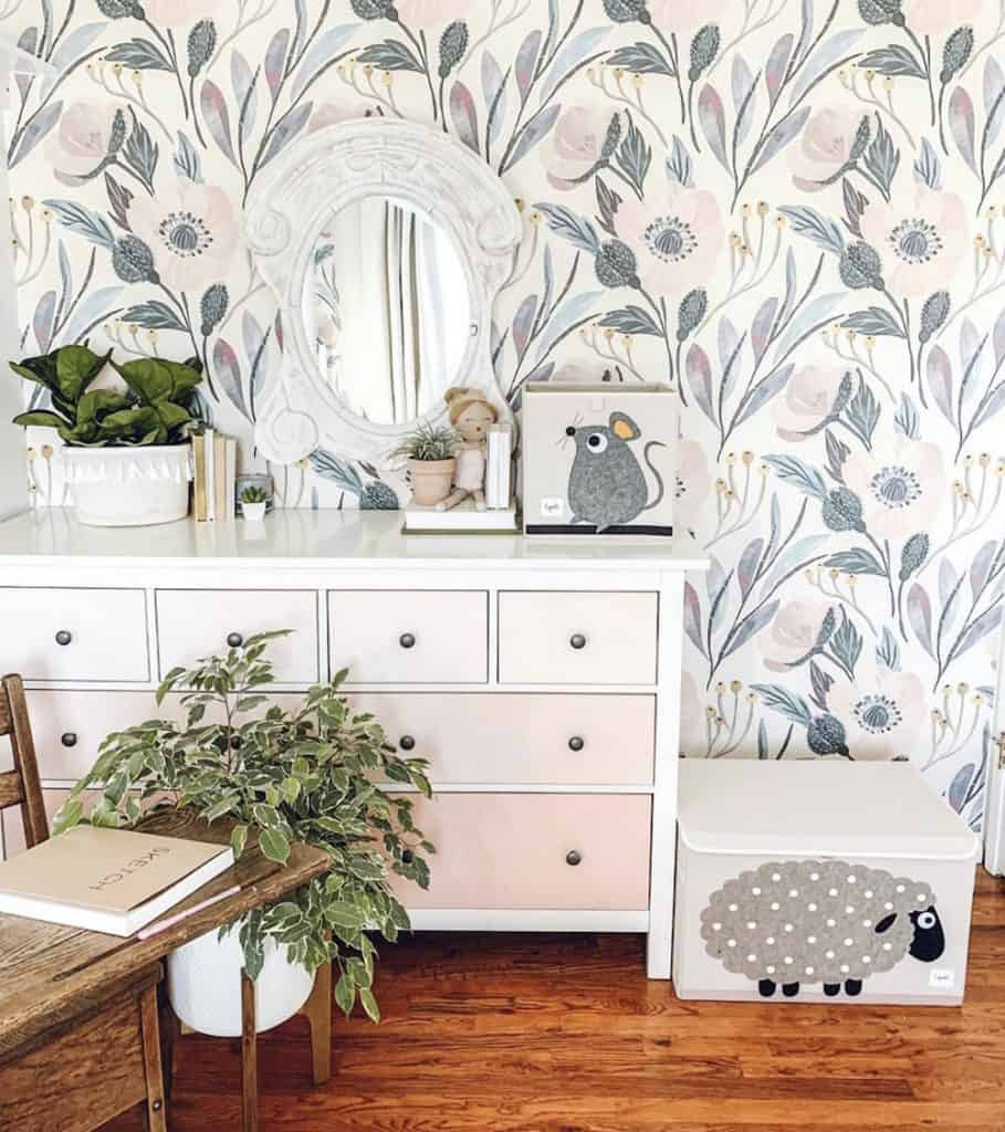 little girls room with floral wallpaper and pink ombre dresser from ikea