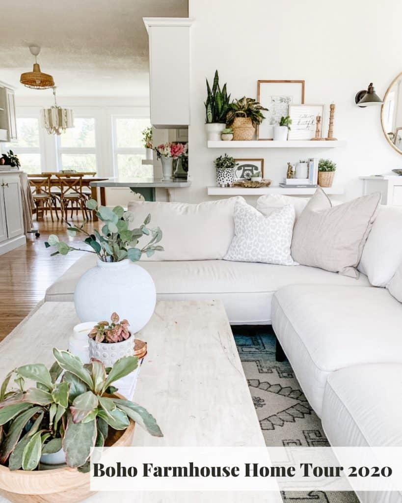living room with white sectional and decorated shelves