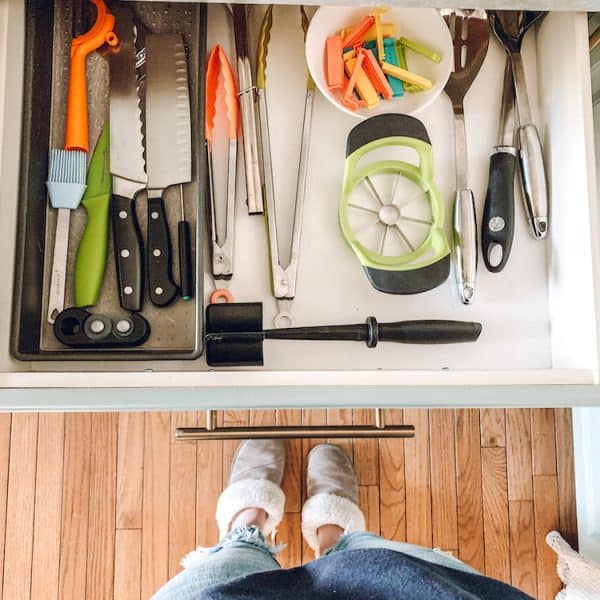 kitchen drawer with knives, spoons, chip clips and tongs