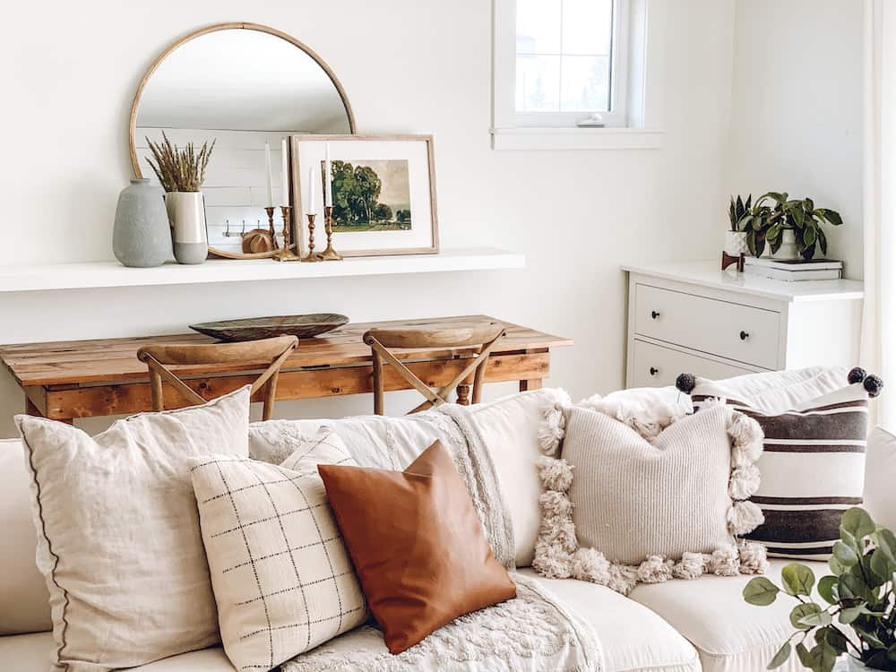 living room with white sectional and throw pillows