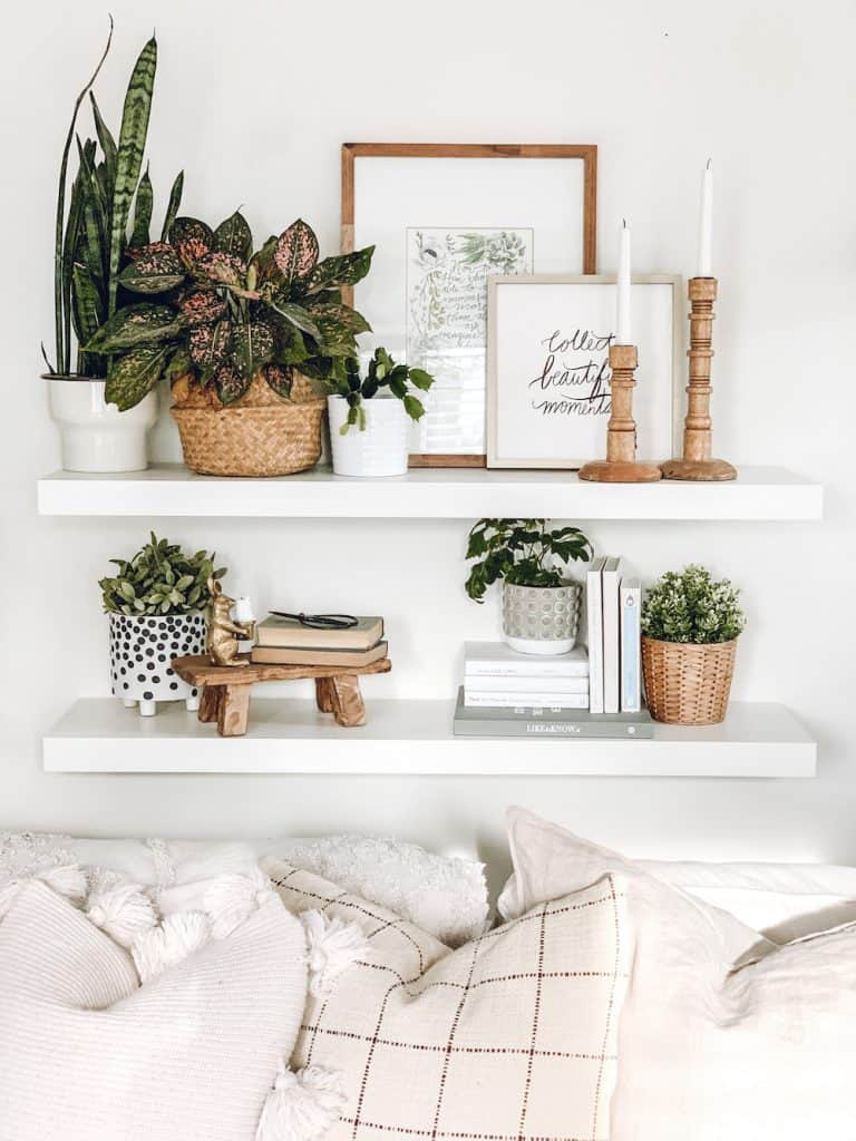 floating white shelves with home decor