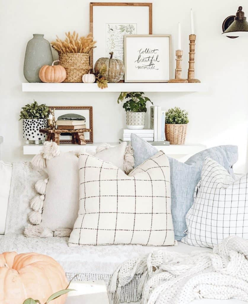 boho pillows and floating shelves with home decor