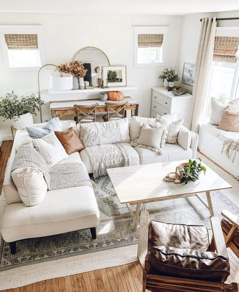 boho decor living room with white sectional and neutral decor