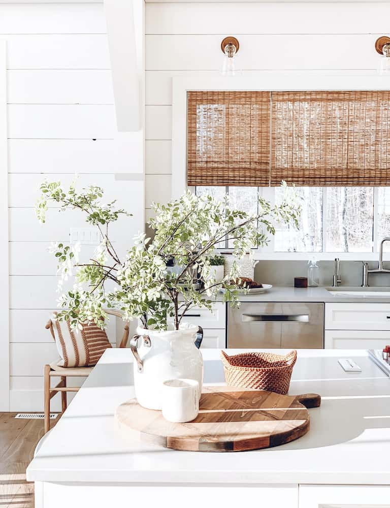 this is a photo of a bright white kitchen with shiplap walls