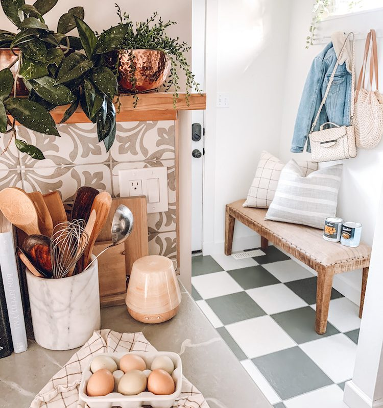 this is a photo of a back entryway with painted checkerboard tile floors