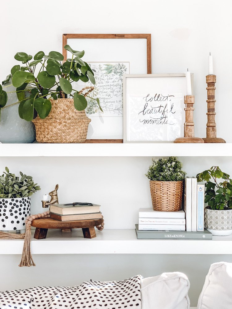 this is a photo of floating shelves with home decor and plants