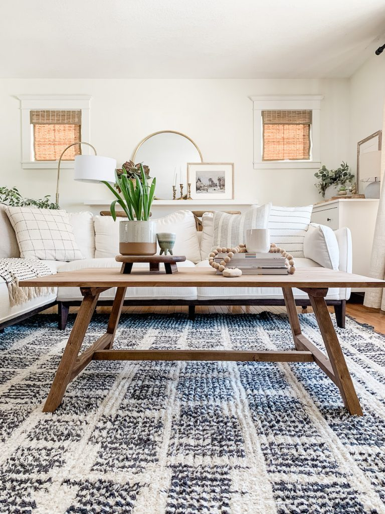 this is a photo of a rustic wooden coffee table in a modern farmhouse living room