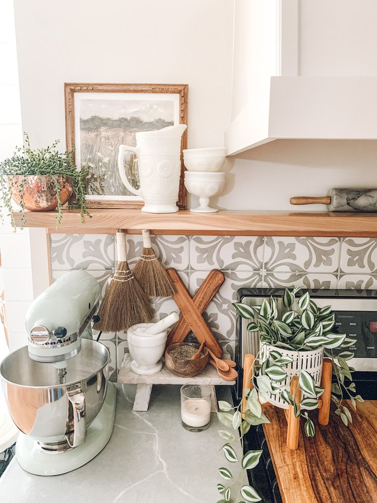 this is a photo of faux plants from ikea on a kitchen counter