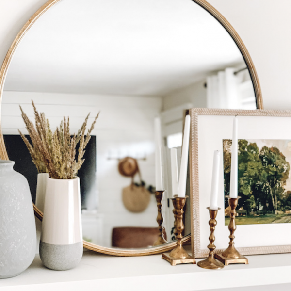 this is a photo of na shelf with a mirror and decor