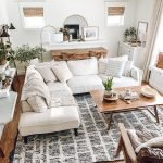 this is a photo of a living room with a large white sectional