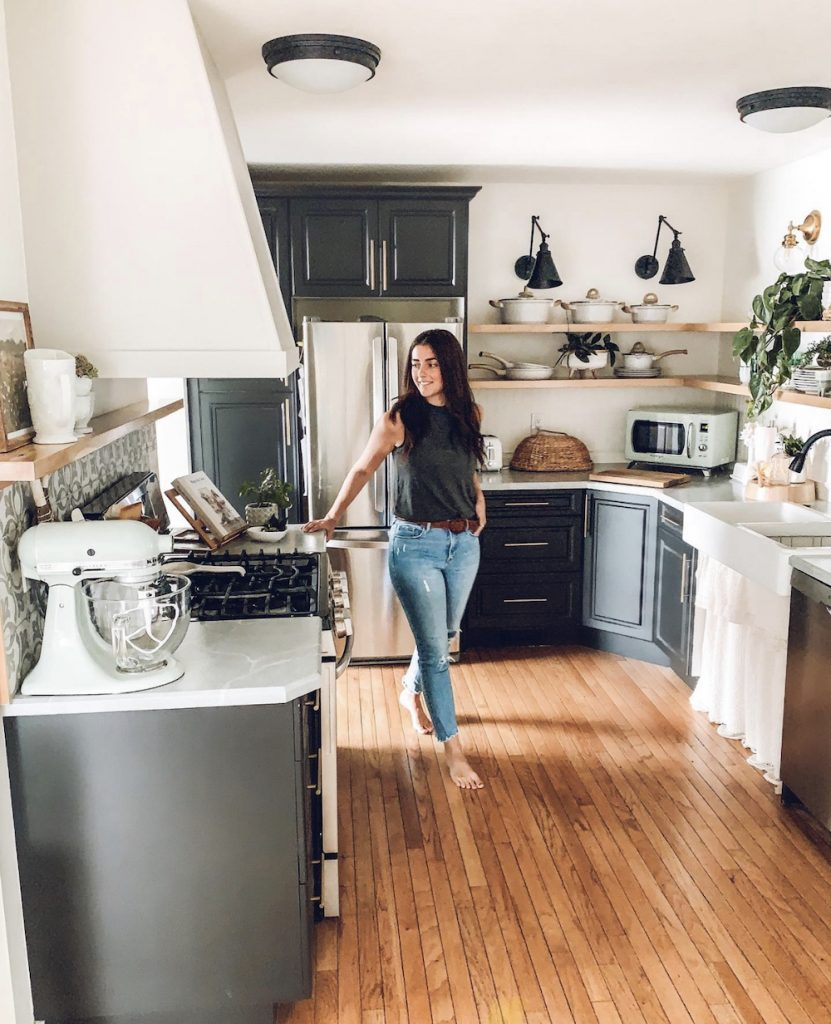 this is a photo of a woman standing in a modern farmhouse kitchen
