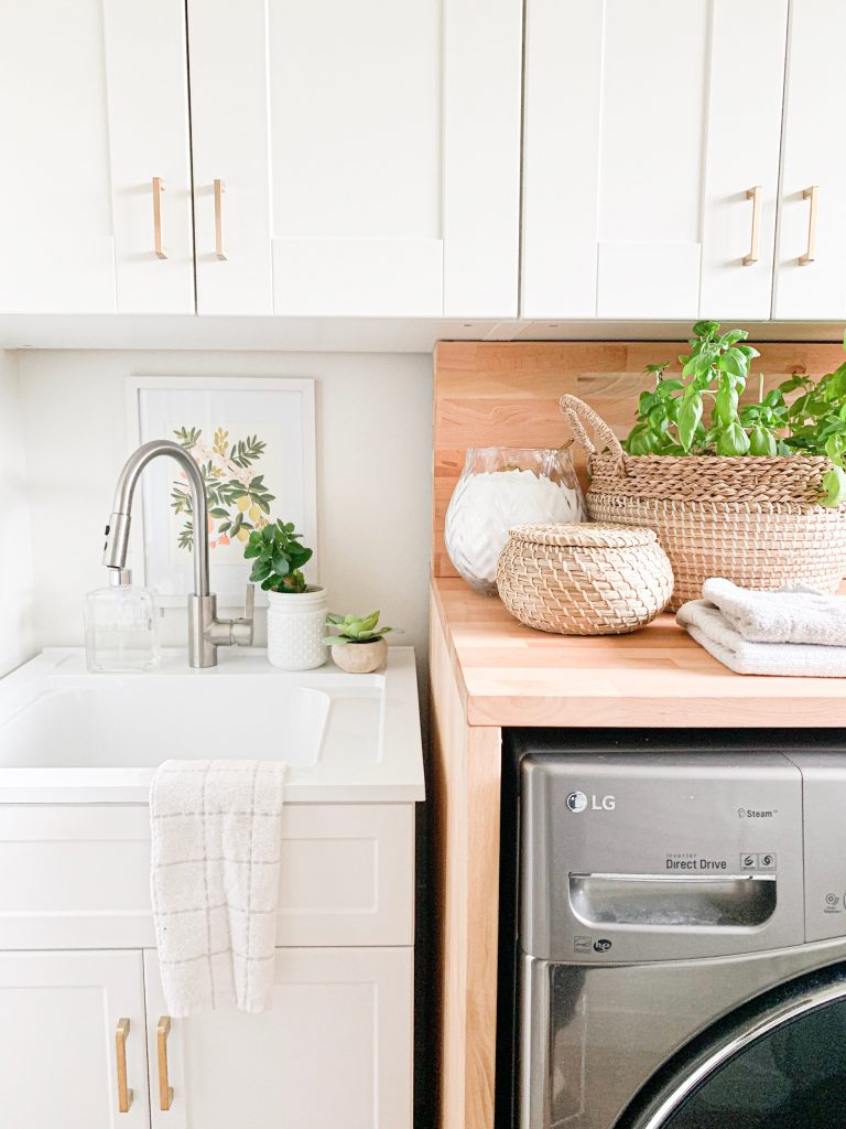 this is a photo of laundry room with a sink