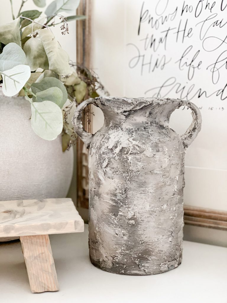 this is a photo of a glass vase transformed to look like old pottery