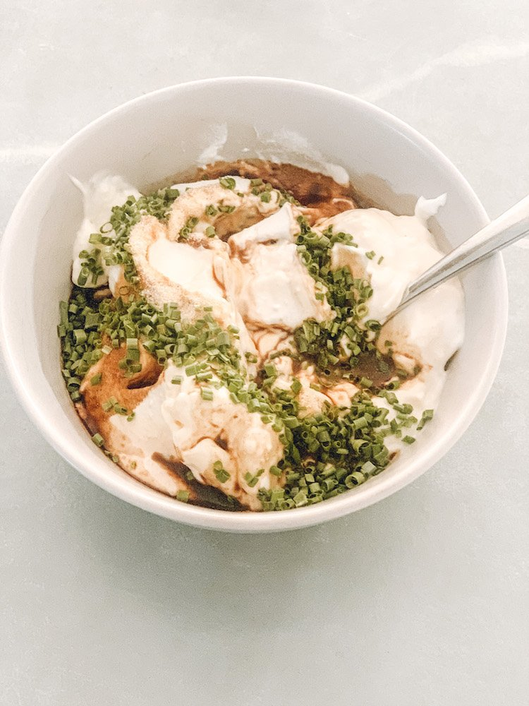 this is a photo of special sour cream sauce - sour cream, mayo, greek yogurt mixed with spices and soy sauce and dried green onions