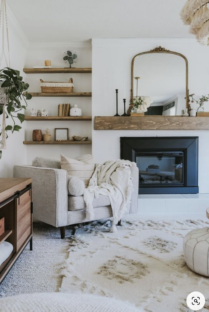 this is a photo of a living room with a fireplace and modern chair