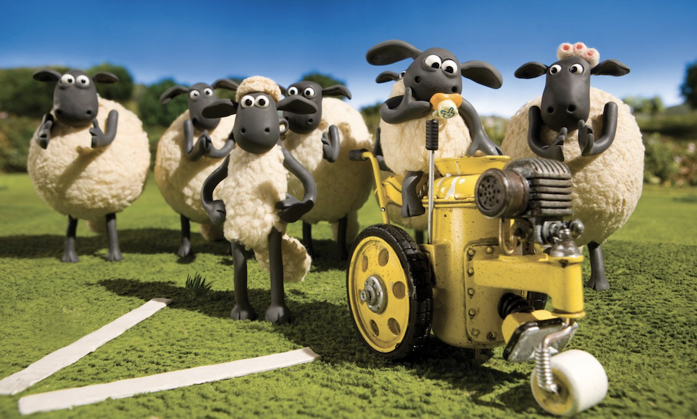 this is a photo of plasticine sheep on a tractor by nick park