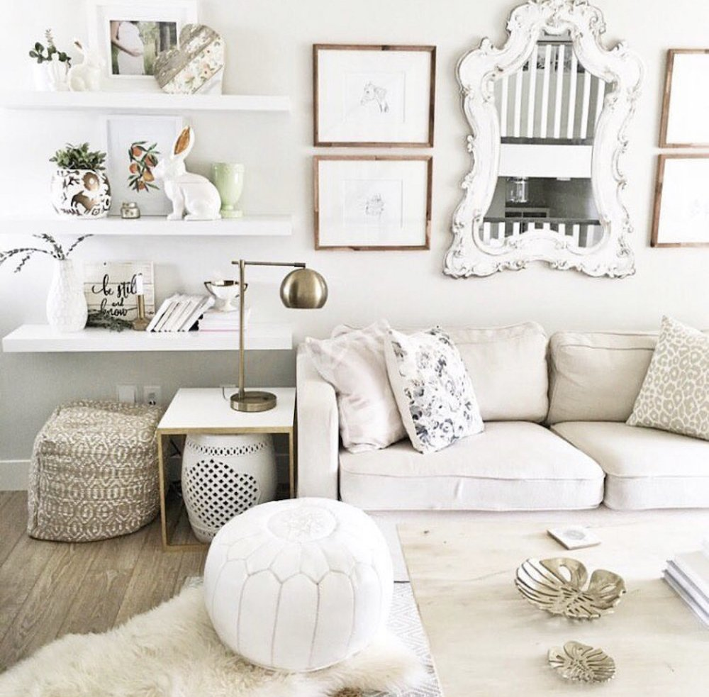 this is a photo with floating shelves in a living room hung at the proper height