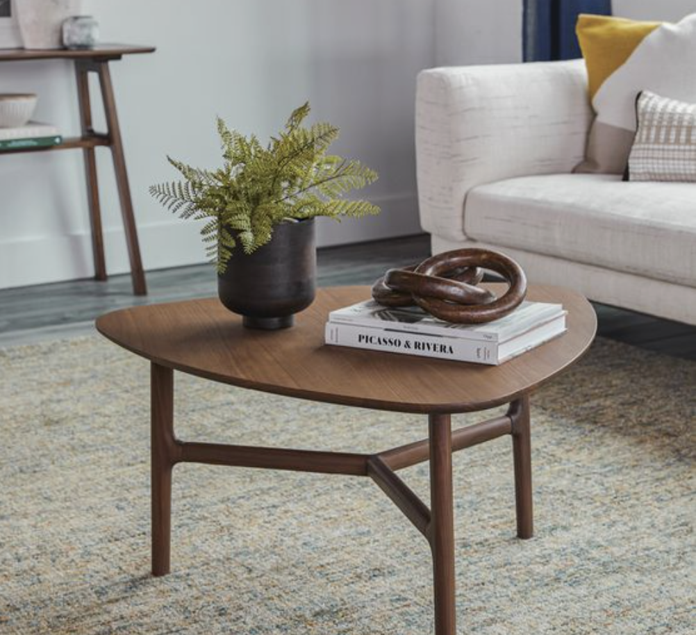 this is a photo of a very small coffee table in a living room