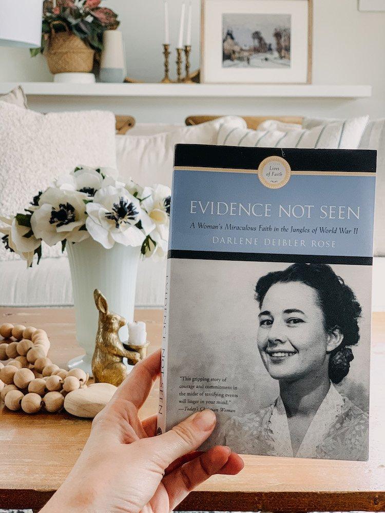 a women holding evidence not seen by Darlene Deibler rose book