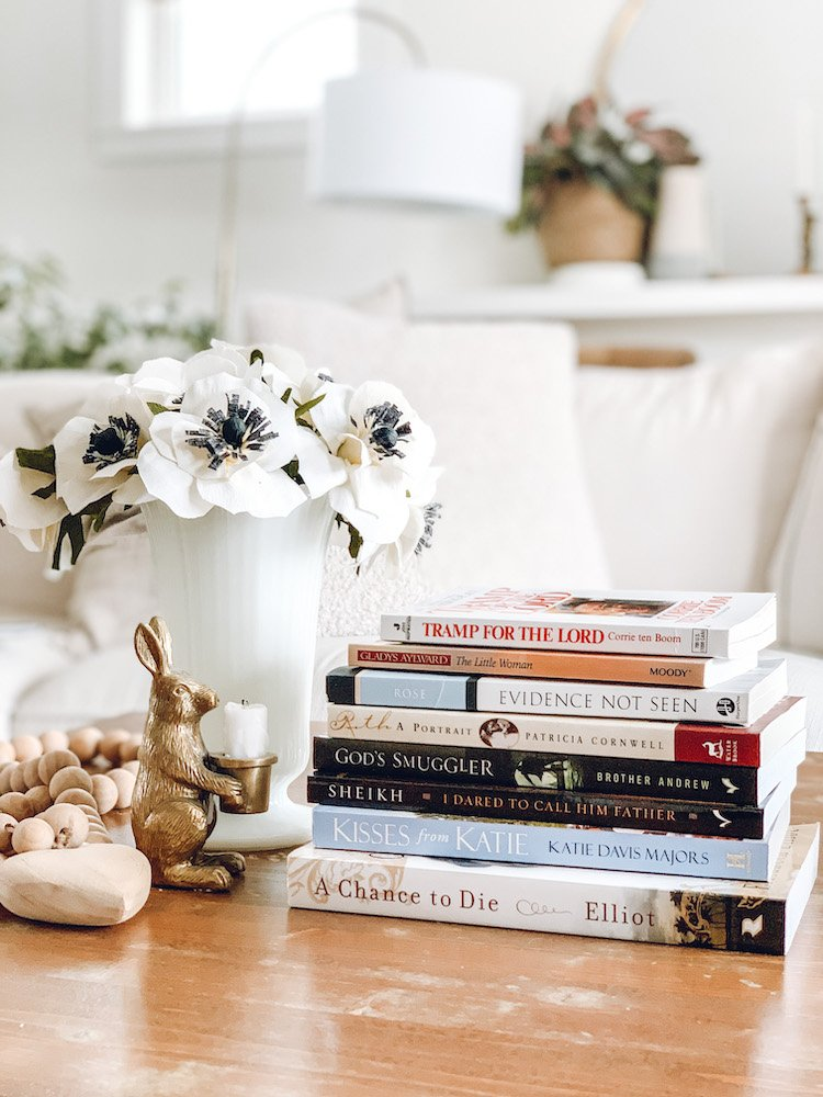 this is a photo of a stack of Christian Biographies on a coffee table