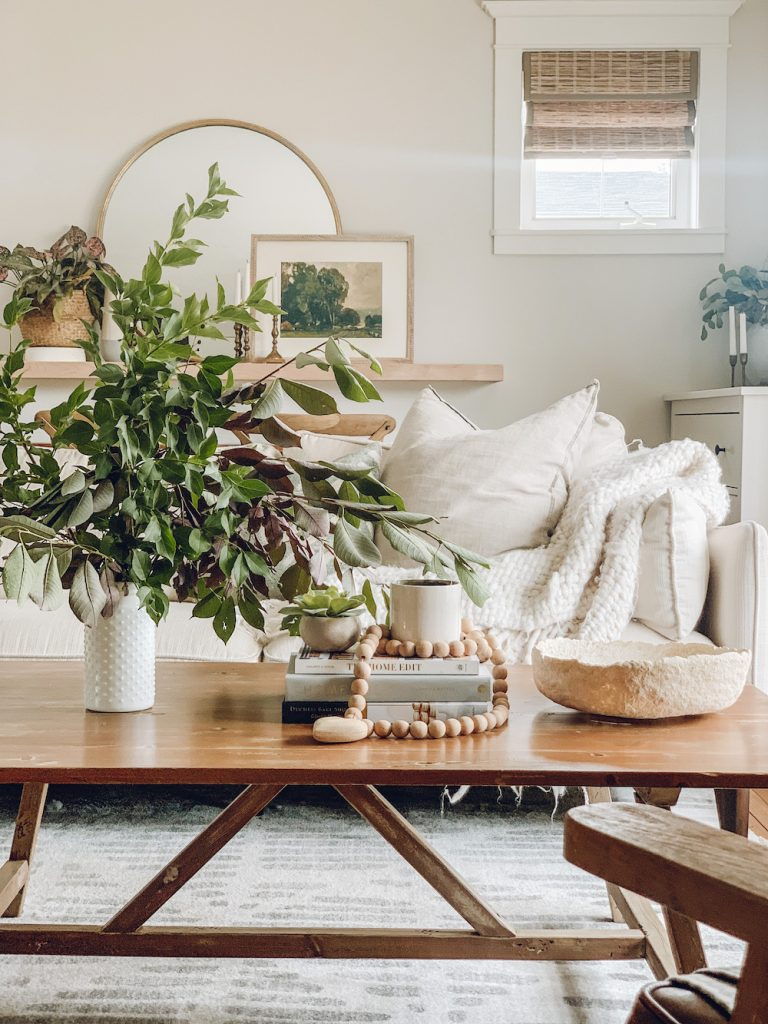 this is a photo of a vase full of b ranches in a boho living room