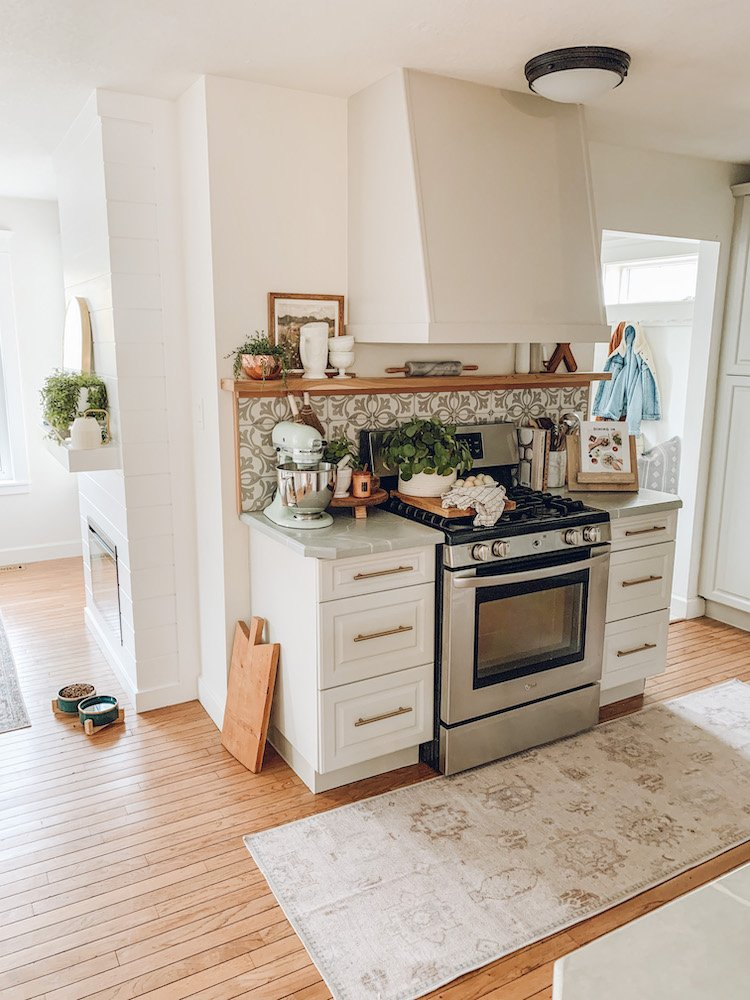 this is a photo of a modern farmhouse kitchen with a washable rug in front of the stove