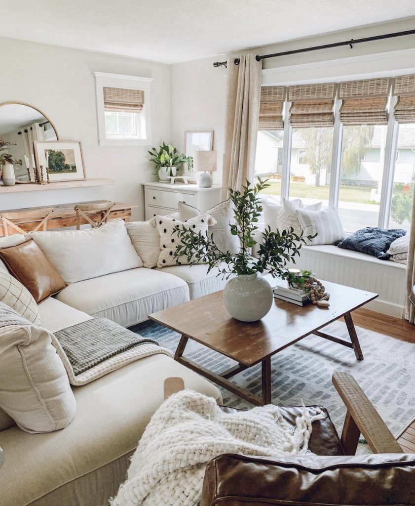 this is a photo of a modern farmhouse living room with woven bamboo window treatments and curtains