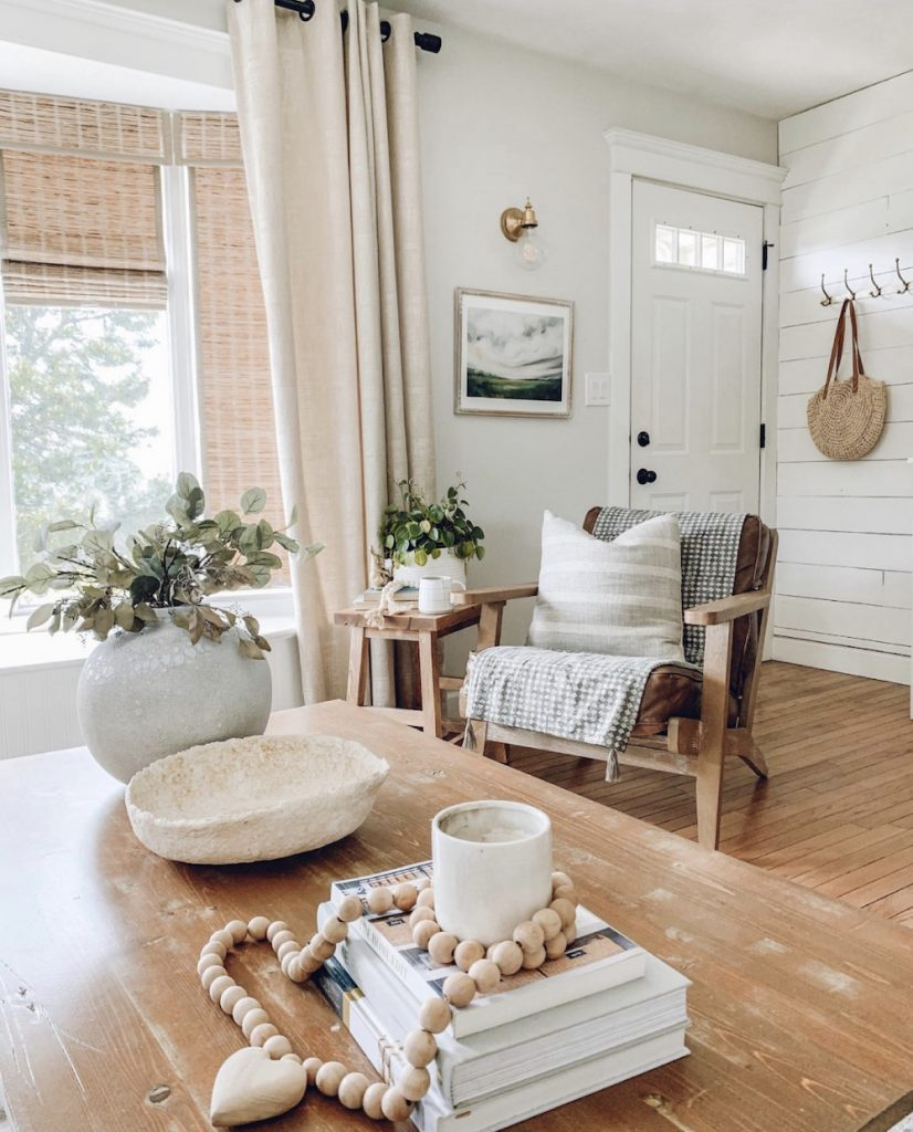 this is a photo of a side chair in a classic grey by Benjamin Moore living room thats rustic and farmhouse in style