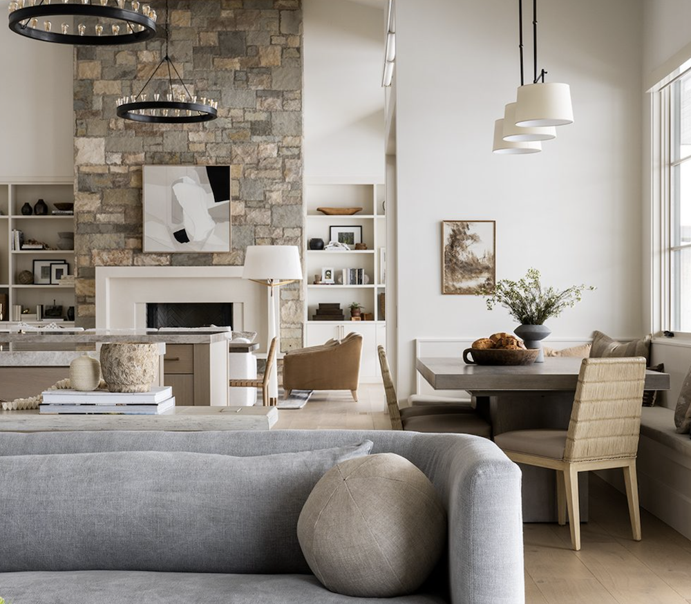 this is a photo of a modern farmhouse living room with large stone fireplace
